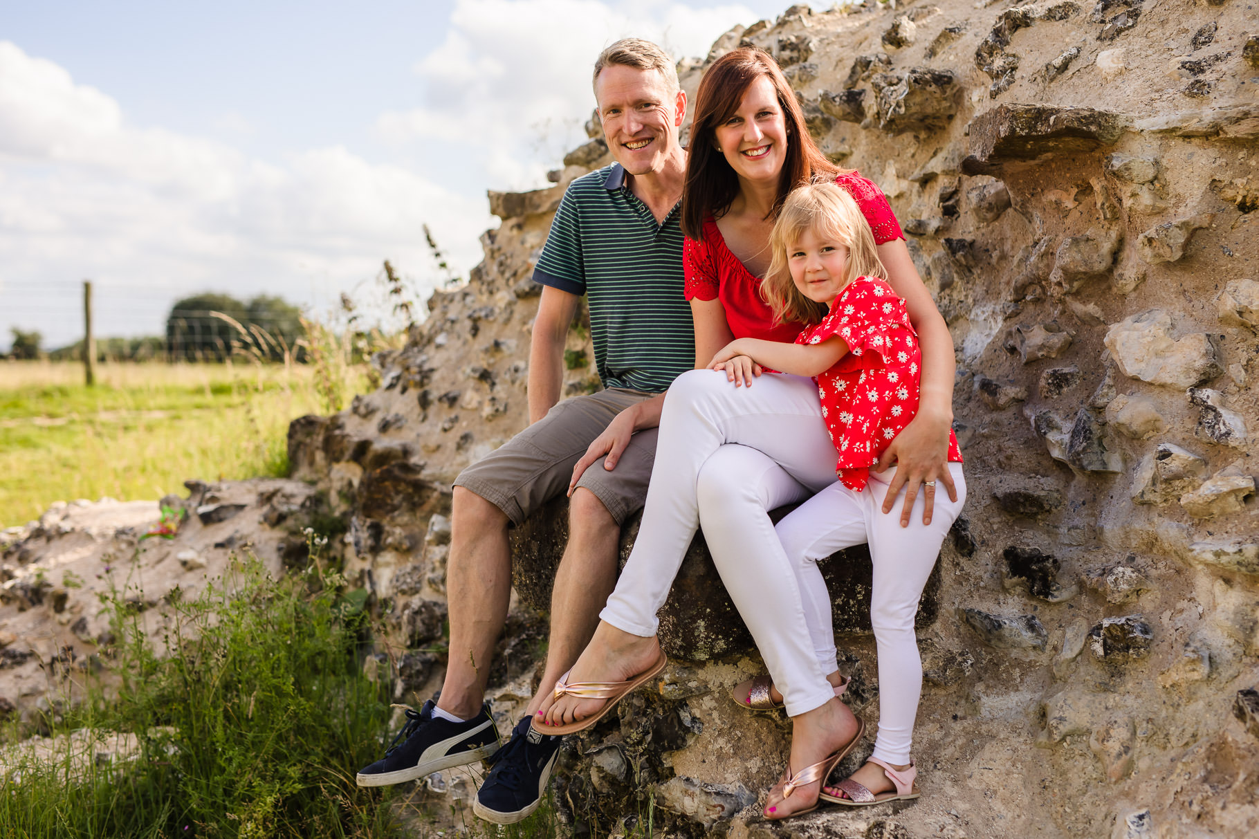 Family portrait sitting on a wall at Silchester Roman City Walls and Amphitheatre