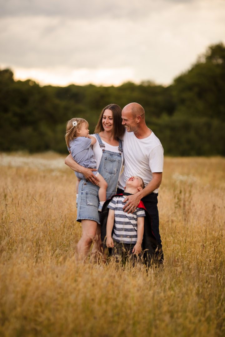 Family of four in an outdoor family photoshoot