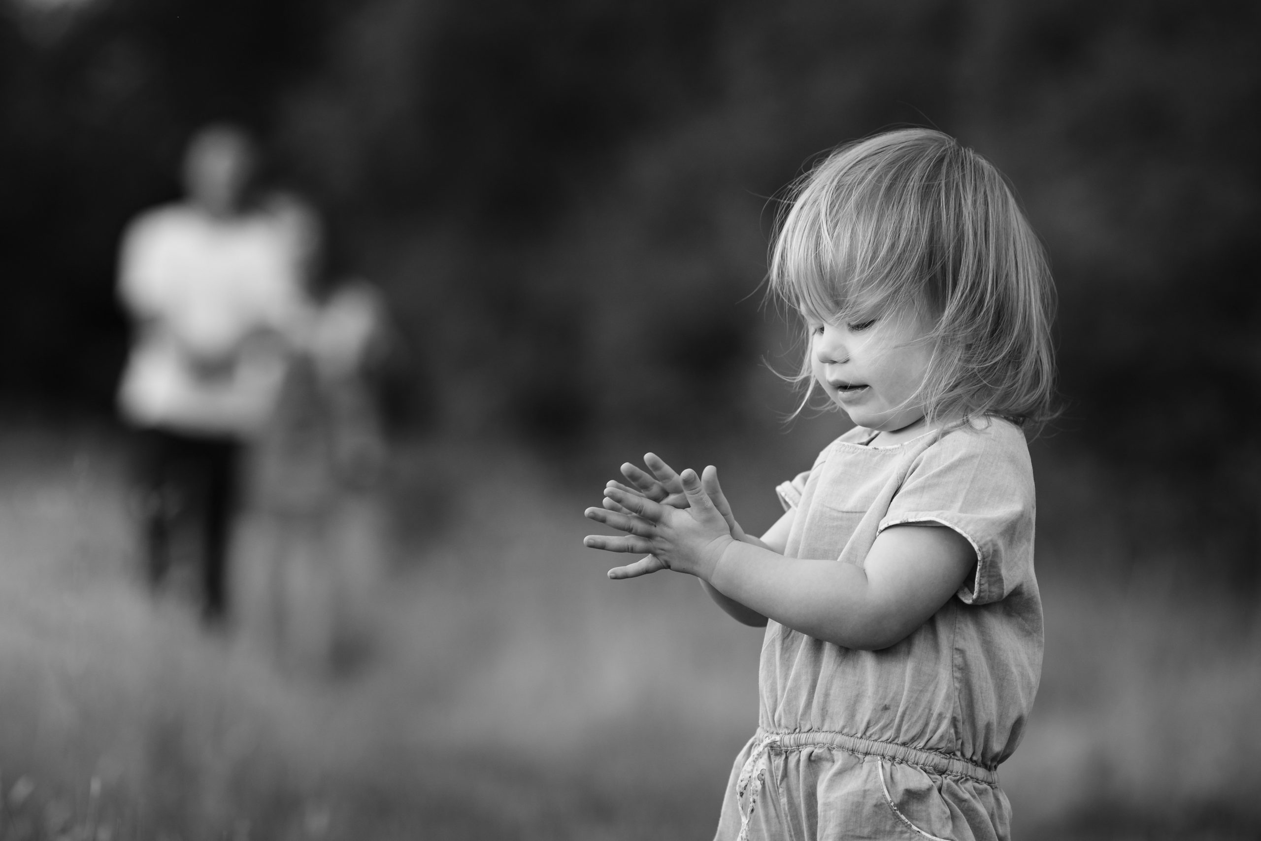 Black and white photo of girl wiping hands