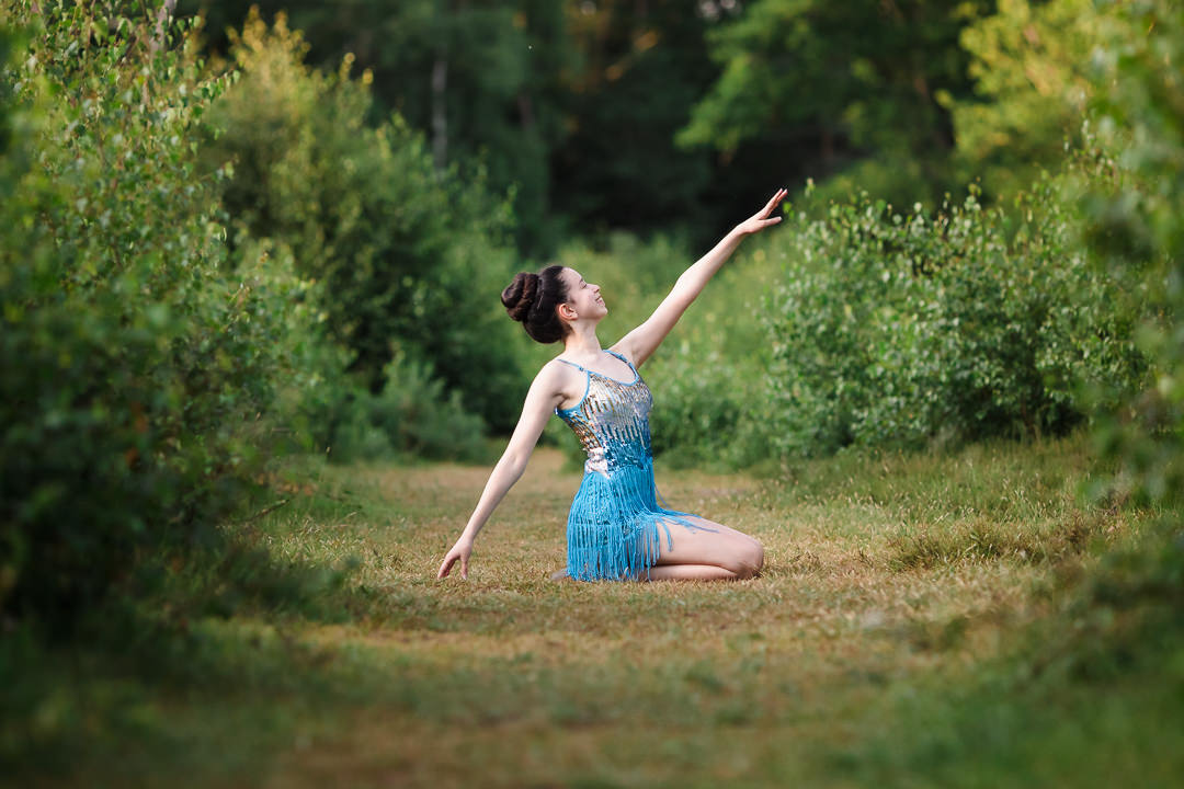 Girl in blue sequin tassel dress in dance photo shoot pose