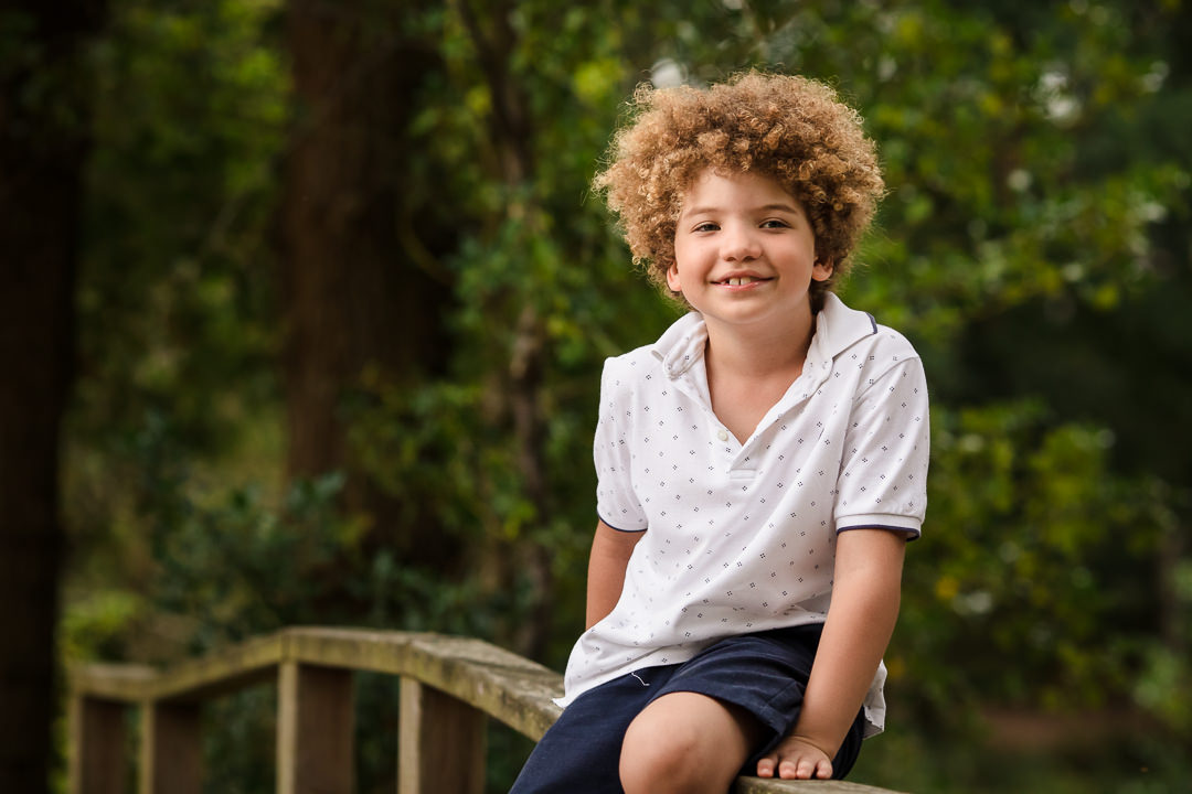 Boy sat on fence at Lightwater Country Park Surrey