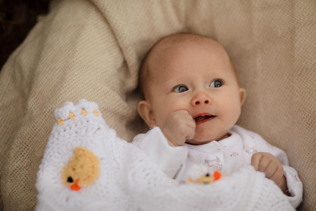 Portrait of baby holding baby blanket