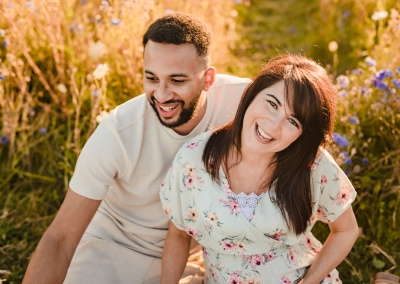 Close up portrait of couple smiling on an outdoor maternity photo shoot