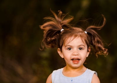 Photo of girl jumping with pigtails flying in the air