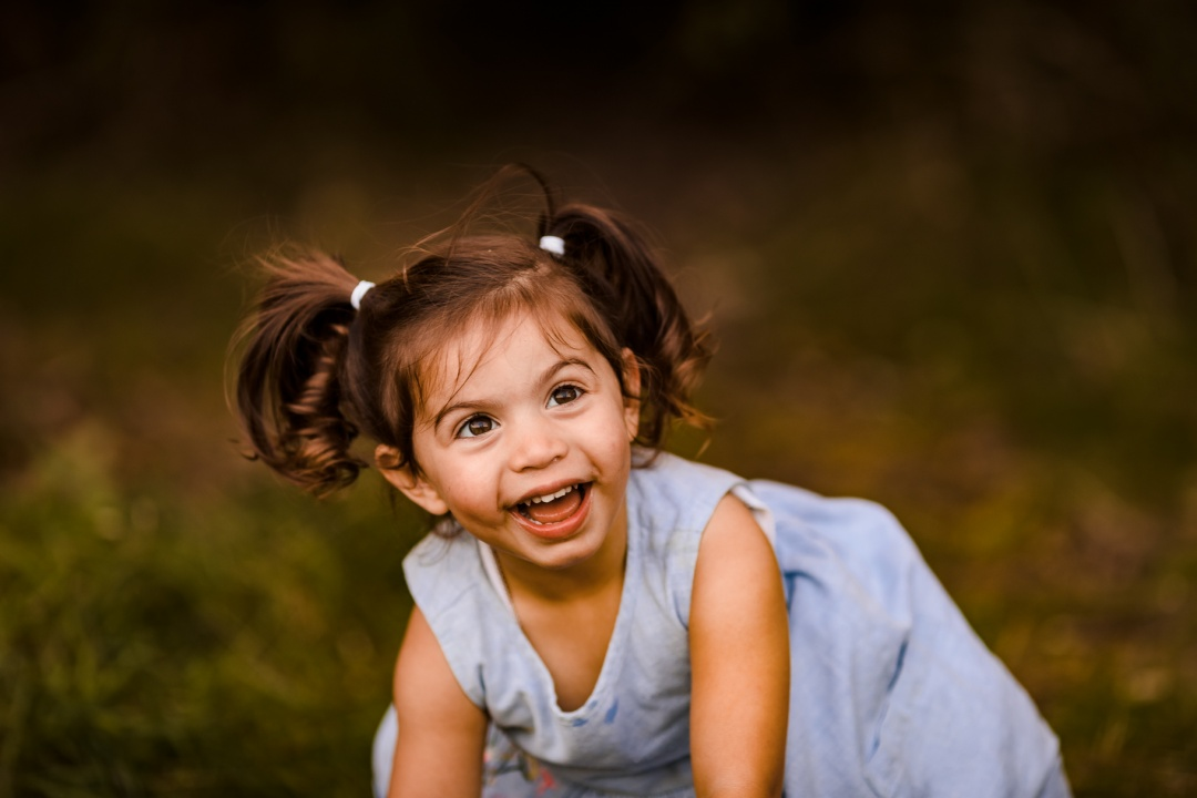 Photo of girl with pigtails laughing