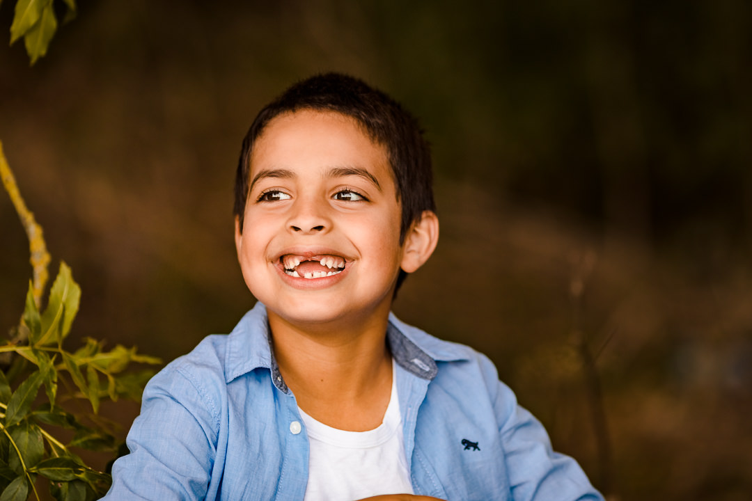 Portrait of boy smiling missing two front teeth
