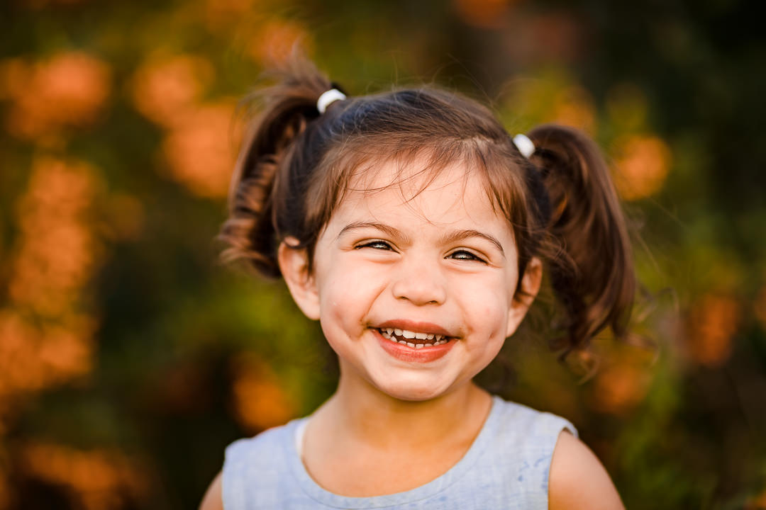 Portrait of a girl with pigtails smiling