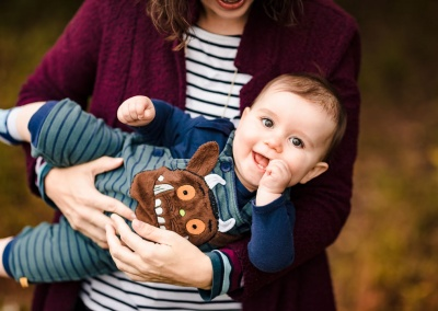 Mum holding son wearing a gruffalo outfit on an autumn photo shoot near Sulham