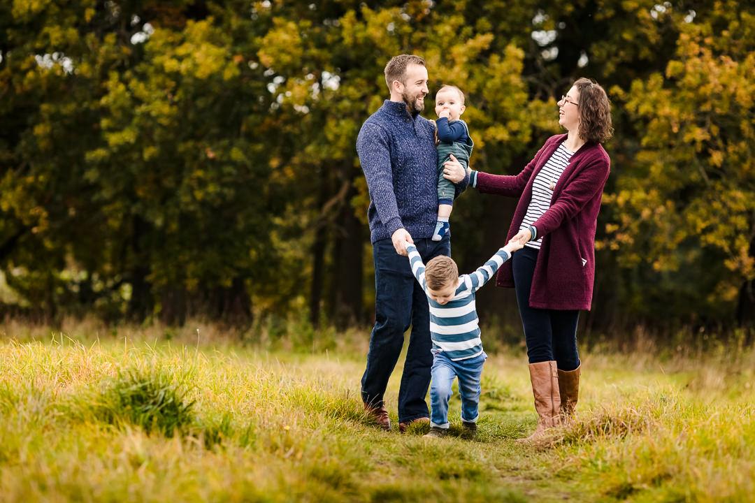 Family on an autumn photo shoot near Sulham Woods
