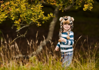 Portrait of boy wearing a tiger hat on an autumn photo shoot near Sulham