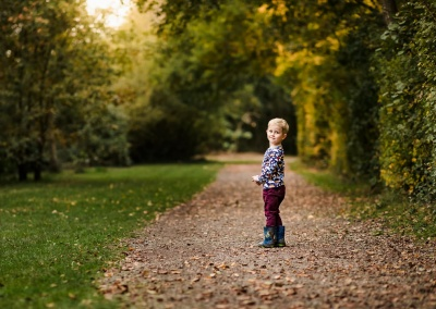 Environmental portrait of boy at Dinton Pastures Country Park on an Autumn Autumn Photo Shoot
