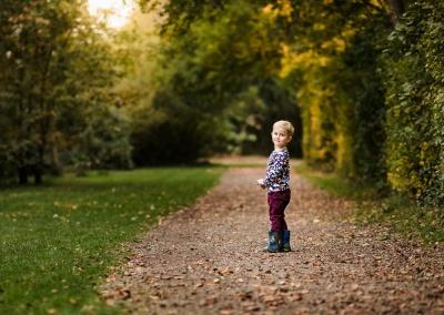 Environmental portrait of boy at Dinton Pastures Country Park on an Autumn Autumn Photo Shoot