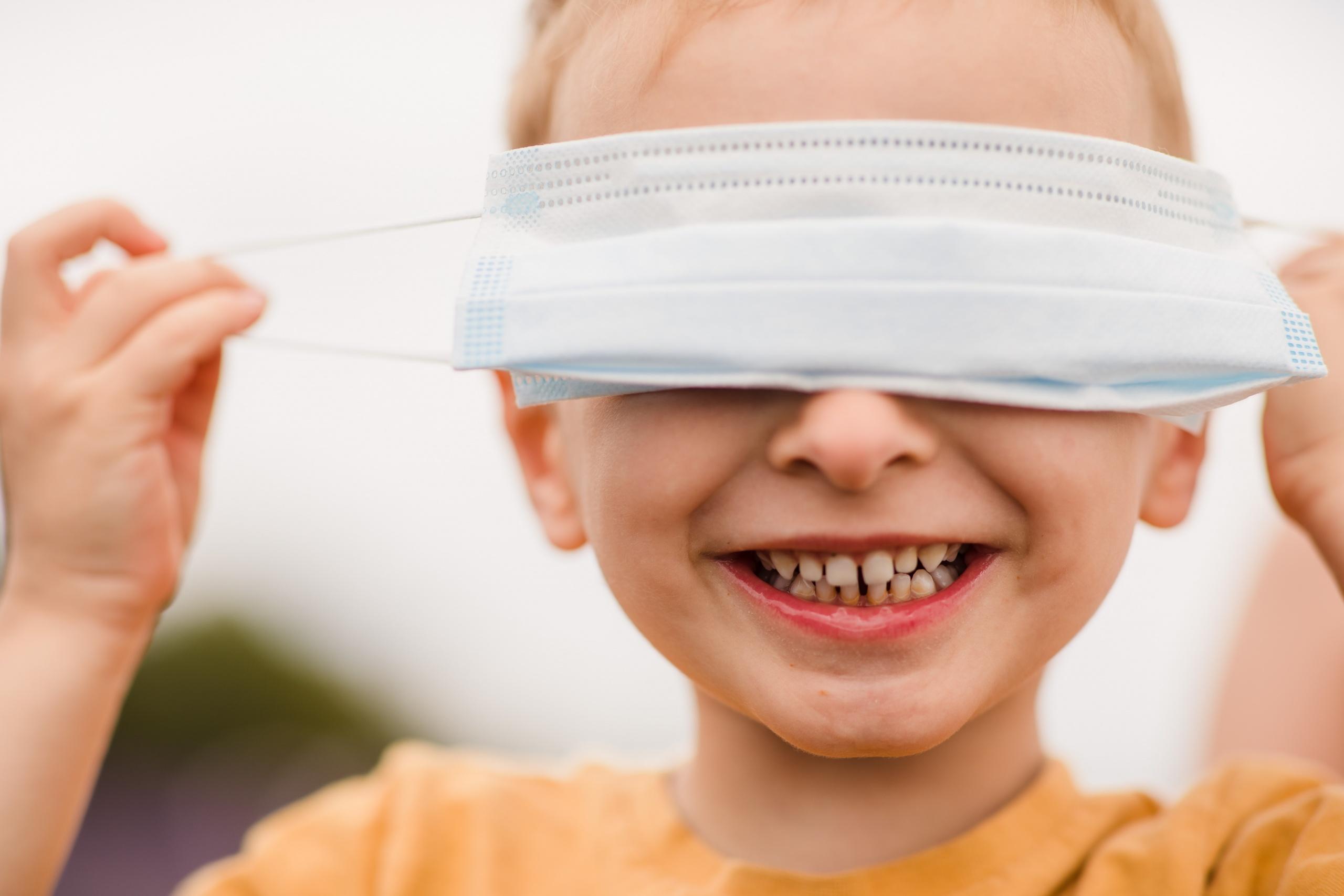 Boy wearing face mask during the coronavirus UK lockdown