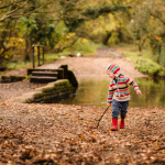 Photograph of boy with a stick on walk around Arborfield Cross